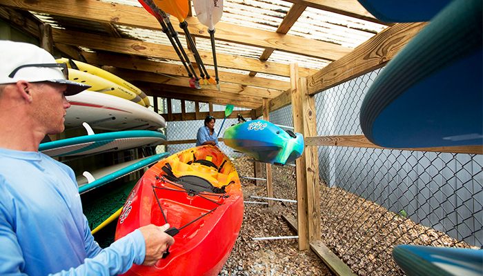kayaks in shed