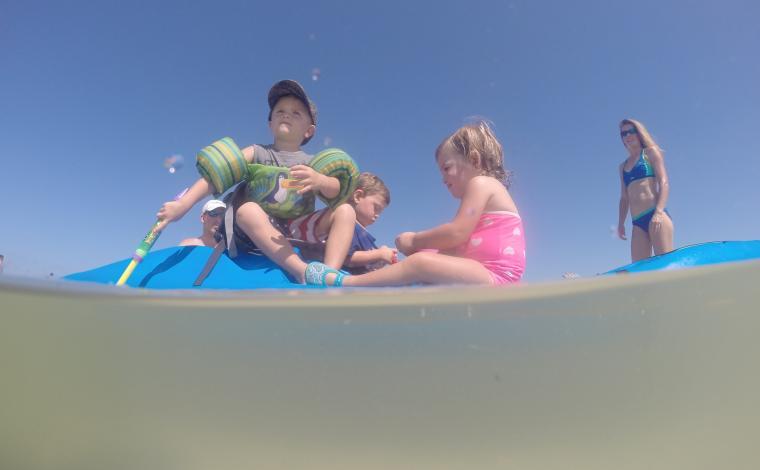 toddlers enjoying themselves on a Perception kayak